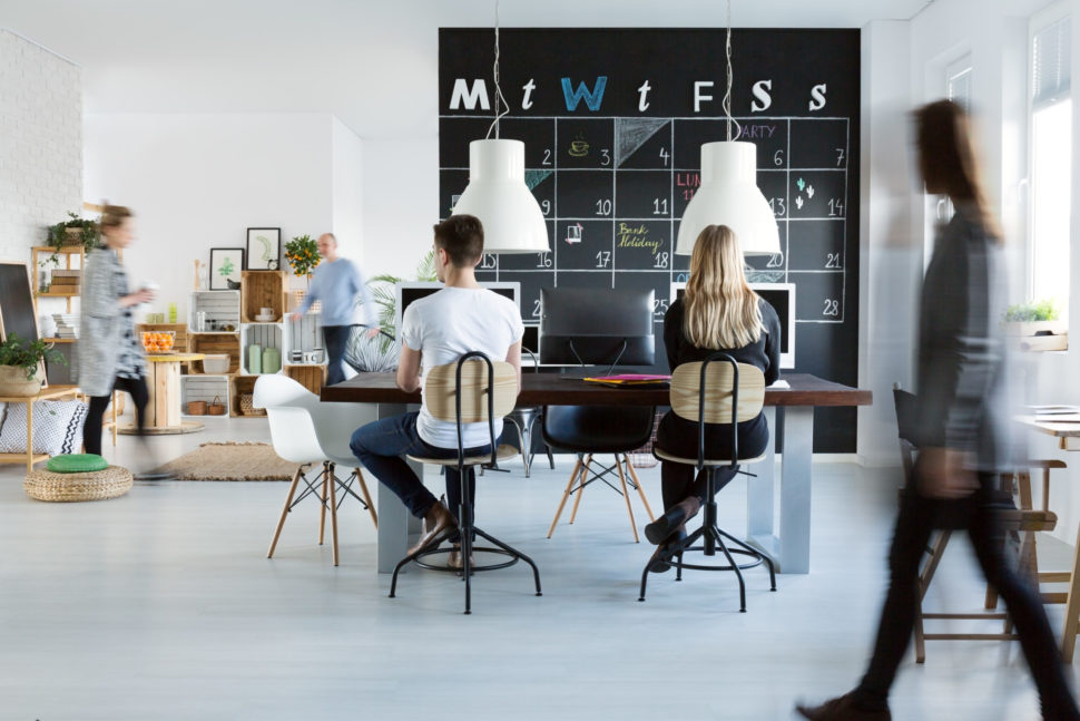 Young people working in trendy friendly office
