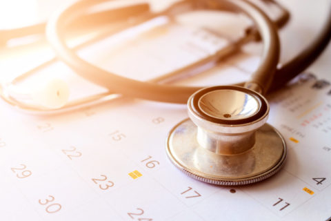 annual checkup concept. stethoscope on the calendar with soft-focus and over light in the background