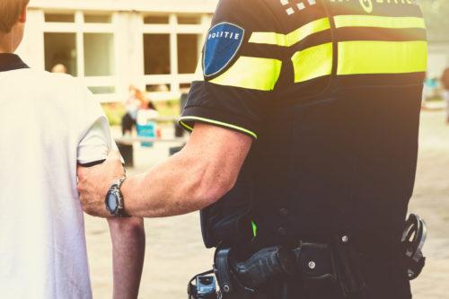 Police arresting a boy at school